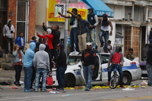 Blacks Riot Destroy Police Car in Baltimore April 2015
